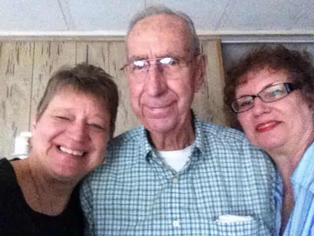 My grandpa with my aunt and my mom on his 91st birthday. My mom is the one with short hair, my aunt in the red lipstick.